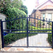 Automatic Swinging Gates with Circle Detail and Spear Tops